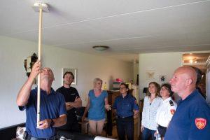 Delegatie WZN brandweer, vrijwillegers bij plaatsen rookmelders